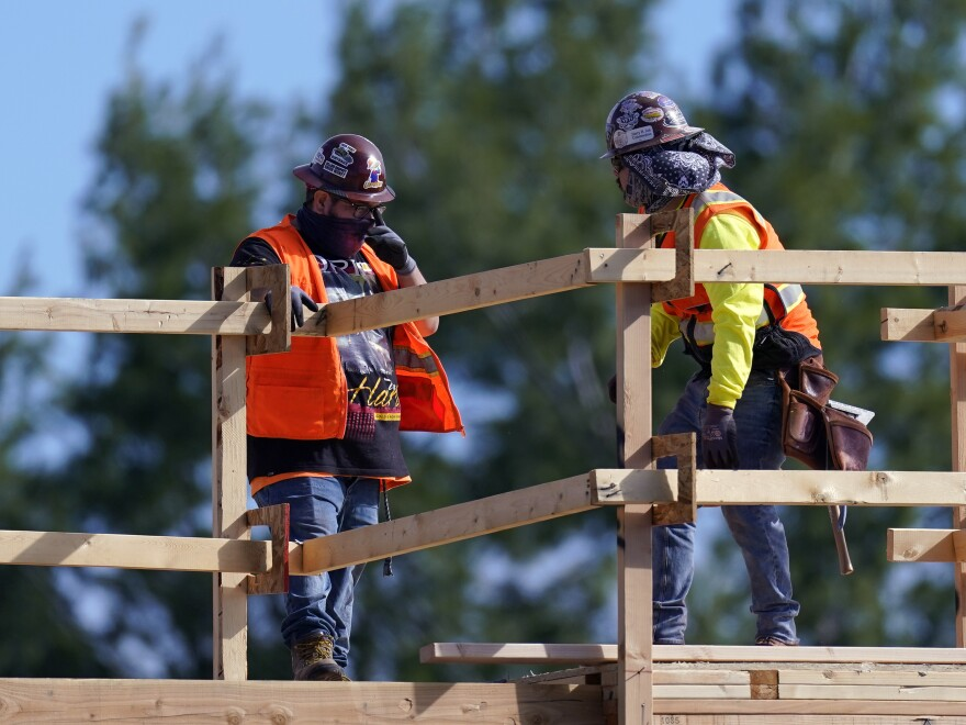 Construction workers at a site in Simi Valley, Calif., on Feb. 2. Nationally, hiring resumed in January although the labor market still has a big hole to climb out of.