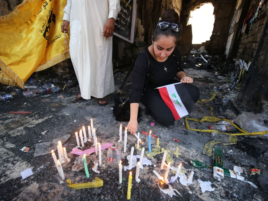 An Iraqi woman mourns at the site of a July 3 attack, claimed by Islamic State, which killed at least 292 people. Baghdad's security chief has since been fired, but outrage at the government remains high.