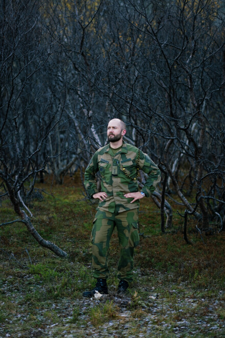 Capt. Sigurd Harsheim stands at the base of the mountains where the observation post sits. Russia is steadily building up military bases and its nuclear arsenal in the Arctic.