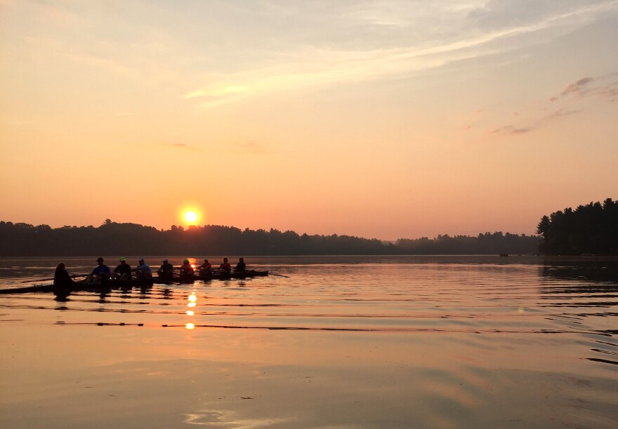 A group of rowers meet at daybreak on Forge Pond in Westford, Mass.