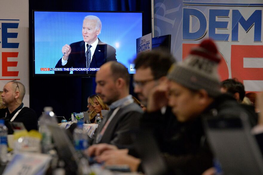 Democratic presidential hopeful former Vice President Joe Biden is seen on a screen in the spin room during debate.