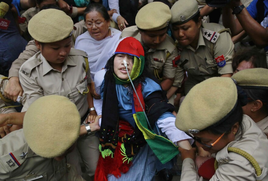 Indian political activist Irom Sharmila is taken back to a hospital after a court appearance in the state of Manipur on Tuesday, a few hours before she ended her fast.
