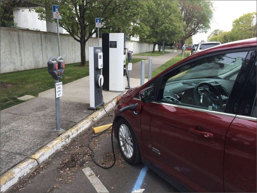 File photo of an electric vehicle charging up outside of the Oregon Capitol.