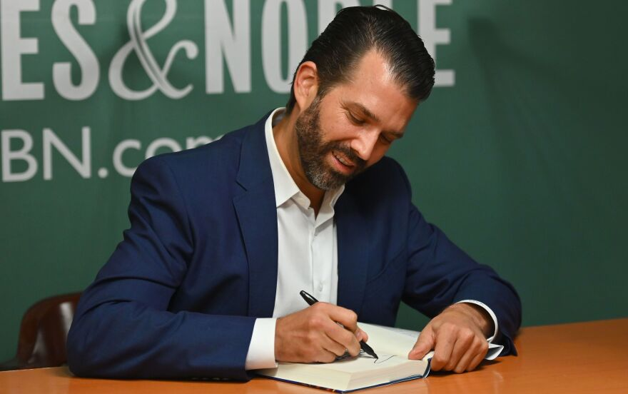 Donald Trump Jr., signs his new book <em>Triggered</em> at the 5th Avenue Barnes & Noble in New York.