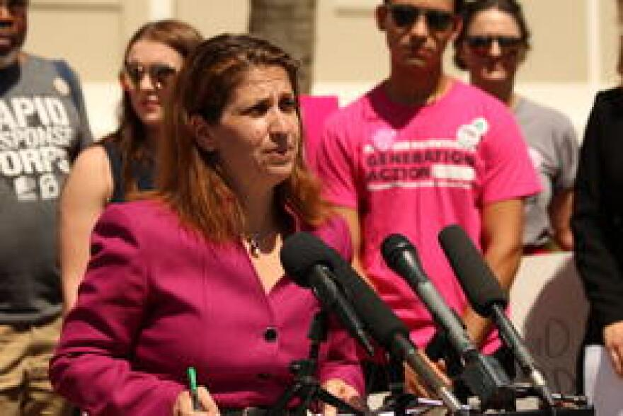 Missy Wesolowski, statewide director of organizing with the Florida Alliance of Planned Parenthood Affiliates, speaks in protest of Brett Kavanaugh's nomination to the U.S. Supreme Court on July 12, 2018