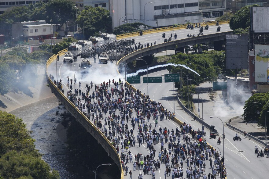 Security forces and armored vehicles block demonstrators marching to the federal ombudsman's office Monday in Caracas, protesting what they believe to be a lack of action against Maduro.