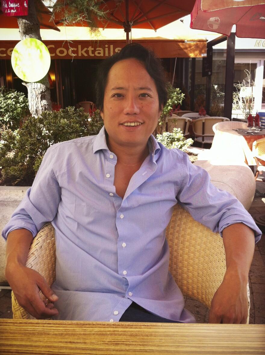 Joji Sakurai sitting at a cafe in France in 2012.