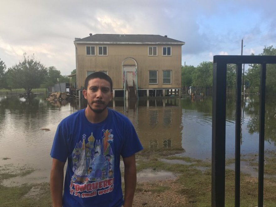 It's a wet trek from Henry Aguirre's front porch to the road, but at least his house in Huffman is dry. It sits about 5 1/2 off the ground.