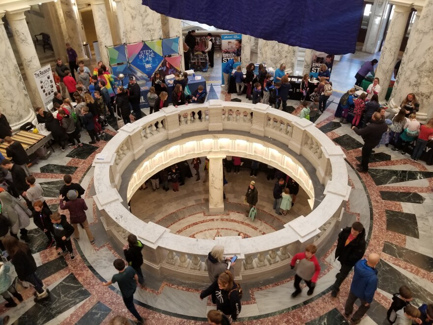Students mill around the Idaho Capitol during a recent STEM event.