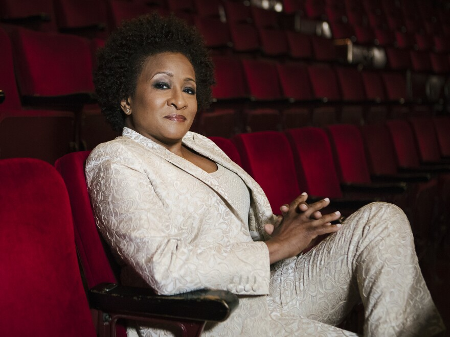 """Wanda Sykes surprised herself by coming out publicly as a lesbian at a 2008 LGBTQ rally in Las Vegas. """"I didn't even know that I was going to do it,"""" she says. """"It wasn't planned at all."""""""