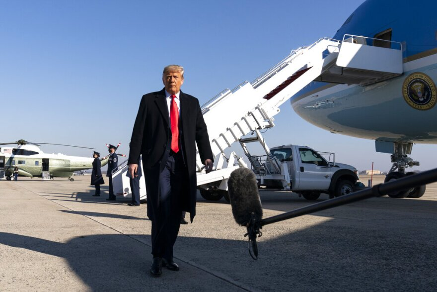 President Donald Trump walks to speak with reporters before boarding Air Force One upon departure, Tuesday, Jan. 12, at Andrews Air Force Base. (AP Photo/Alex Brandon)