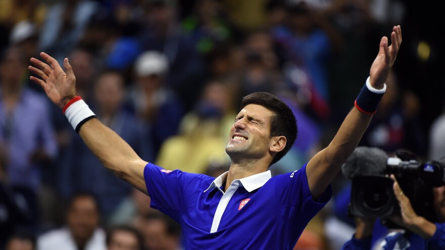 Novak Djokovic of Serbia celebrates after defeating Roger Federer of Switzerland during of their 2015 US Open Men's singles final match on Sunday.