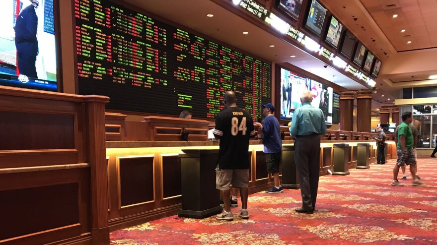 People place bets at the Sports Book at the South Point Hotel and Casino in Las Vegas.
