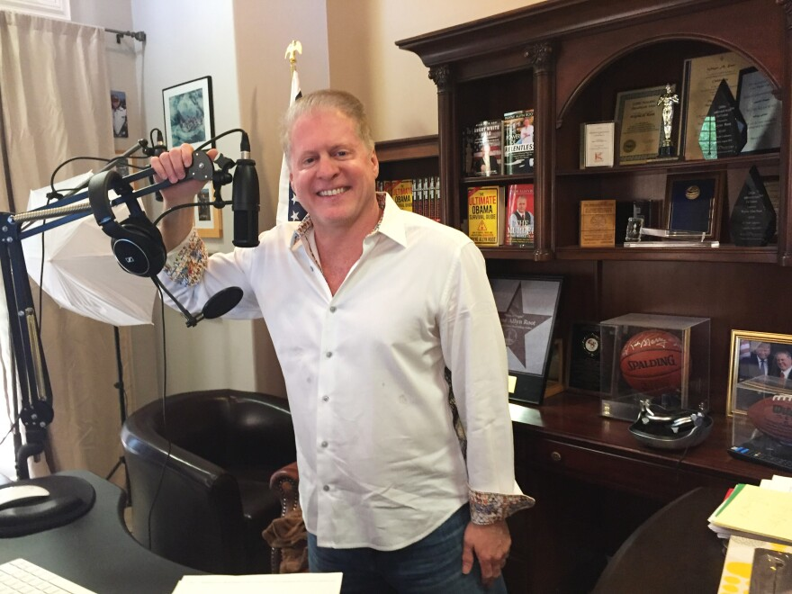 Wayne Allyn Root hosts a conservative talk radio show from his home studio.