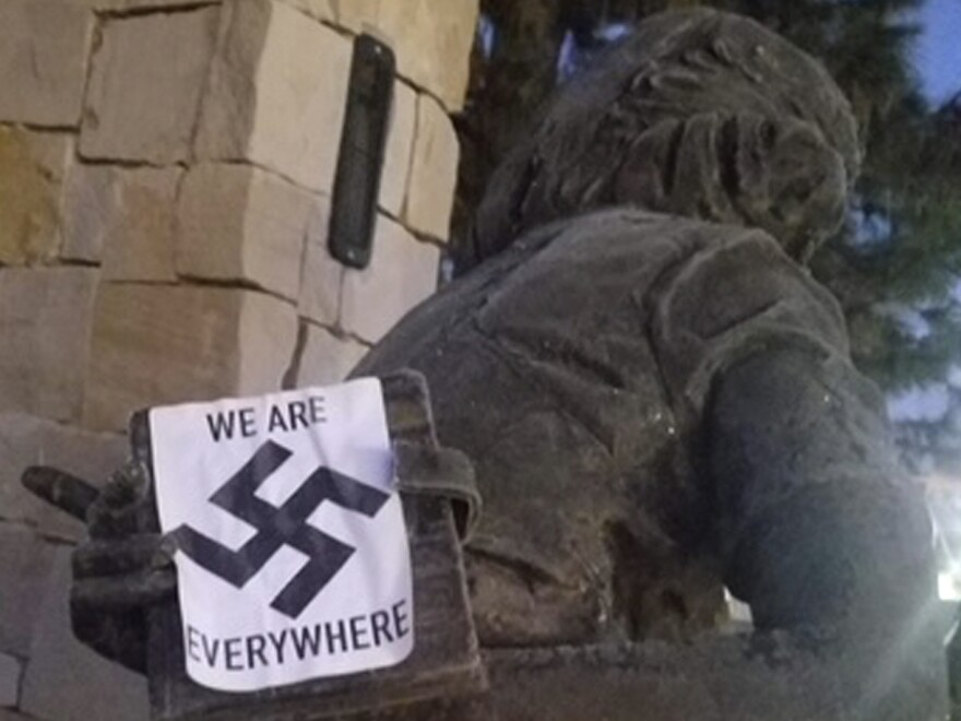 A swastika sticker on a statue at the Idaho Anne Frank Human Rights Memorial in Boise, Idaho. The vandalism took place sometime between Monday evening and Tuesday morning, Boise Police said.