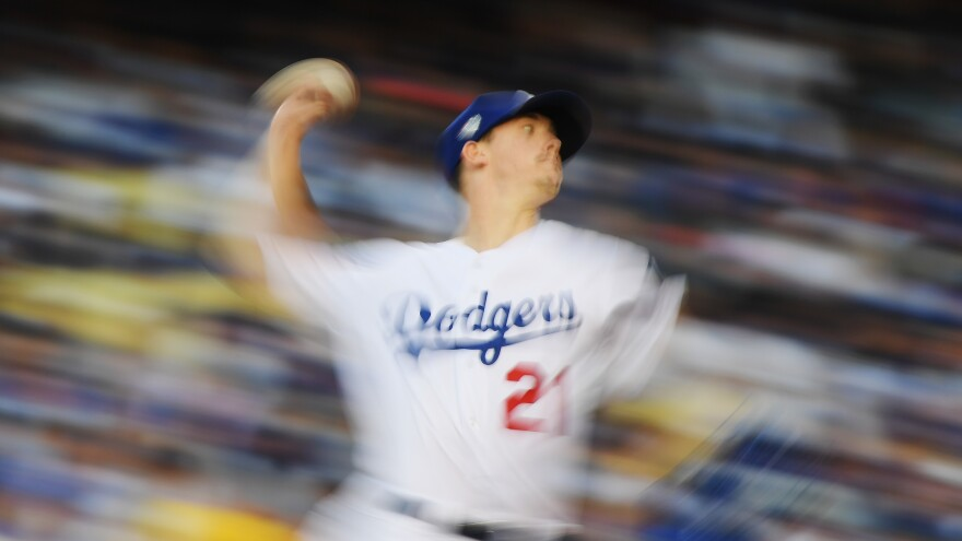 """""""One of God's own prototypes. A high-powered mutant of some kind never even considered for mass production. Too weird to live, and too rare to die."""" Starting pitcher Walker Buehler of the Los Angeles Dodgers throws against the Boston Red Sox on Friday during the second inning in Game 3 of the World Series in Los Angeles. He threw more than 20 pitches faster than 98 mph in the first three innings."""