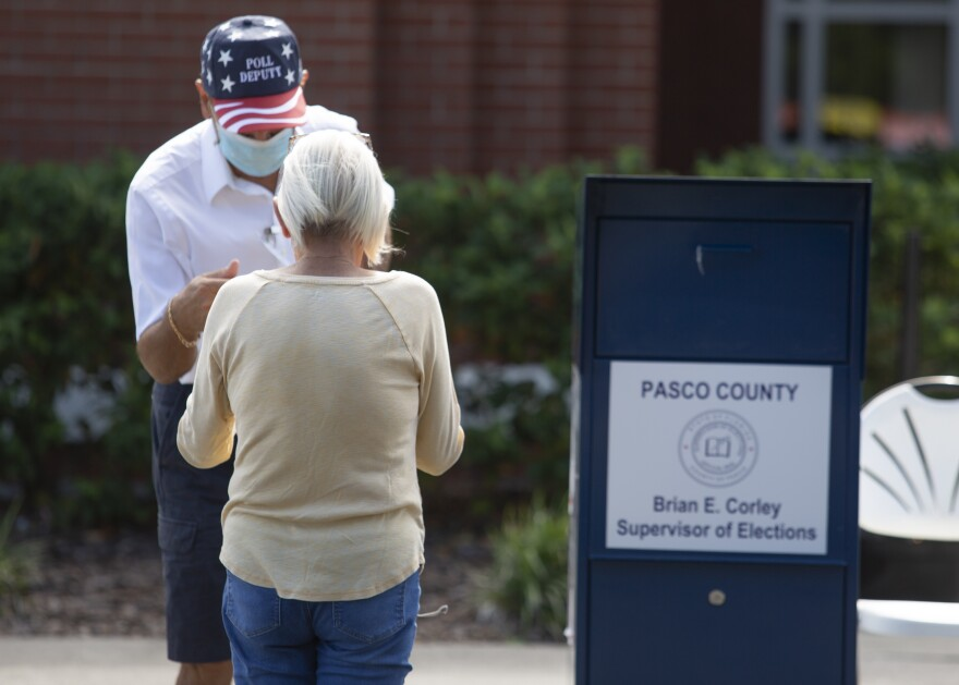 A woman casts her vote at an early voting site in Pasco County.