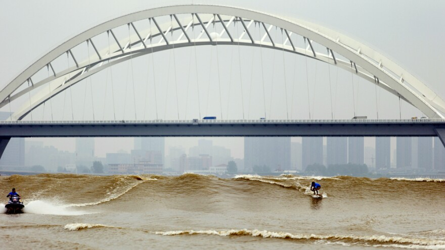 During a surfing competition this week on a river in Hangzhou, China, surfers rode a 10-foot wave. The unusual wave draws international competitors every fall.