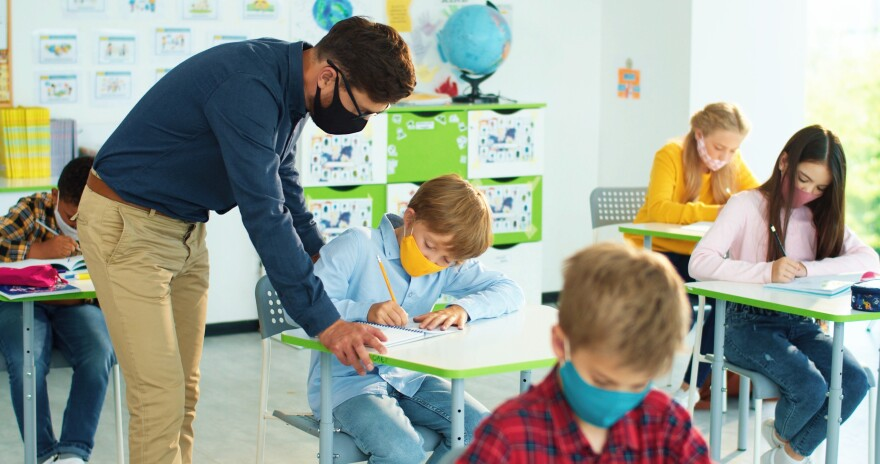 Caucasian,Young,Male,Teacher,In,Mask,Helping,Small,Junior,Student