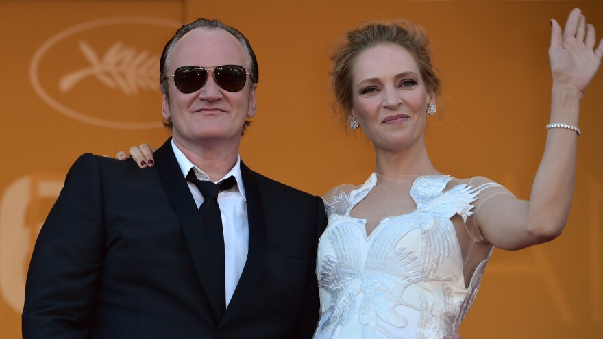 Director Quentin Tarantino and actress Uma Thurman pose at the Cannes Film Festival in 2014. He acknowledges persuading her to do a dangerous driving scene that ended in a crash.
