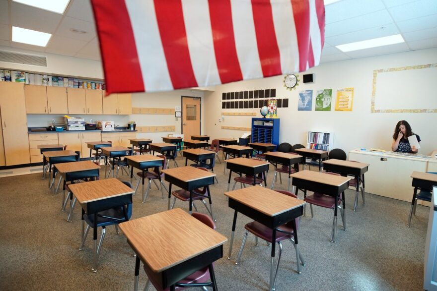 A teacher starts to reset up her classrooms at Freedom Preparatory Academy in Provo, Utah. (Photo by George Frey/Getty Images)