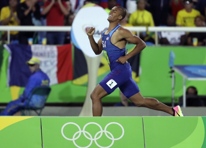 American Ashton Eaton competes in the 1,500 meters, the last event of the decathlon, in Rio on Thursday. He repeated as gold medal winner in the 10-event competition, the first time that's happened in more than three decades.