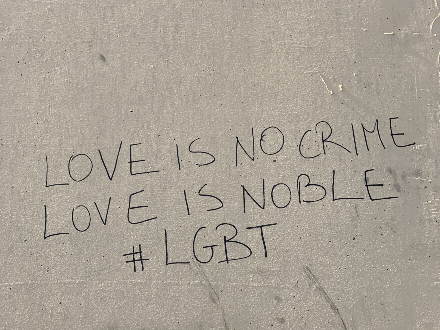 "Graffiti on a wall in Beirut reads, ""Love is no crime, love is noble #LGBT."" The city has been known as a gay-friendly haven — but this year's pride parade was canceled over security concerns."