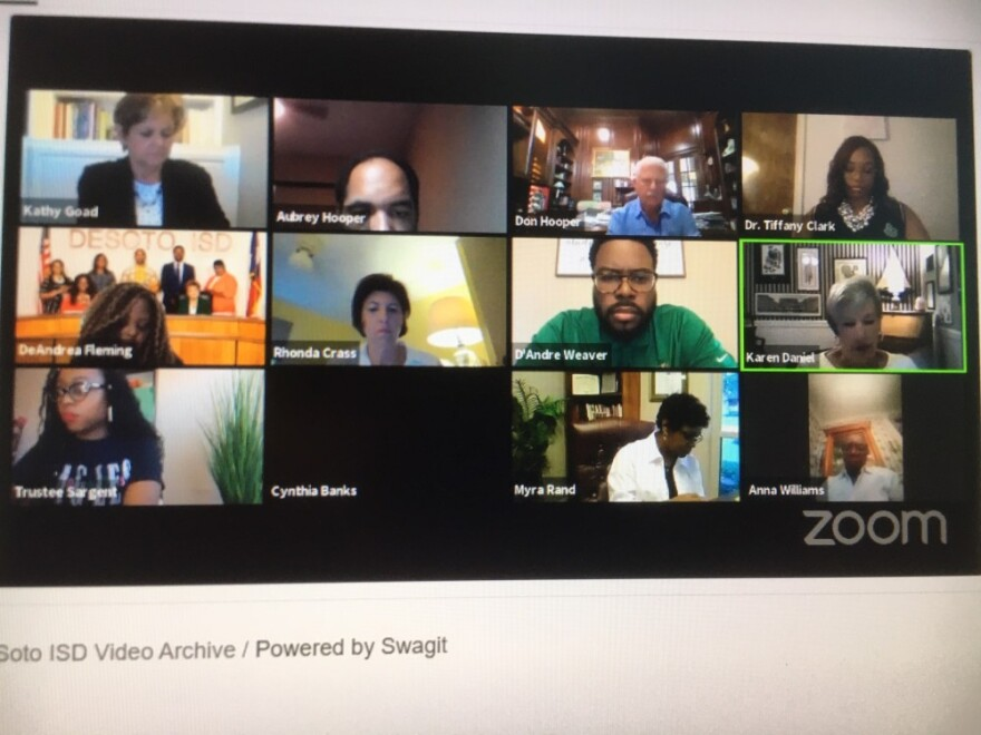 Photo of screen with DeSoto ISD's virtual board meeting via Zoom call on it.