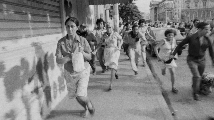 Leftist demonstrators flee after Salvadoran National Guard troops fire into a crowd of protesters on the steps of the San Salvador Cathedral in May 1979.