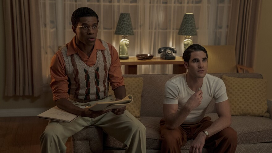 Screenwriter Archie (Jeremy Pope, left) and wannabe director Raymond (Darren Criss) run lines in the Netflix miniseries <em>Hollywood</em>.
