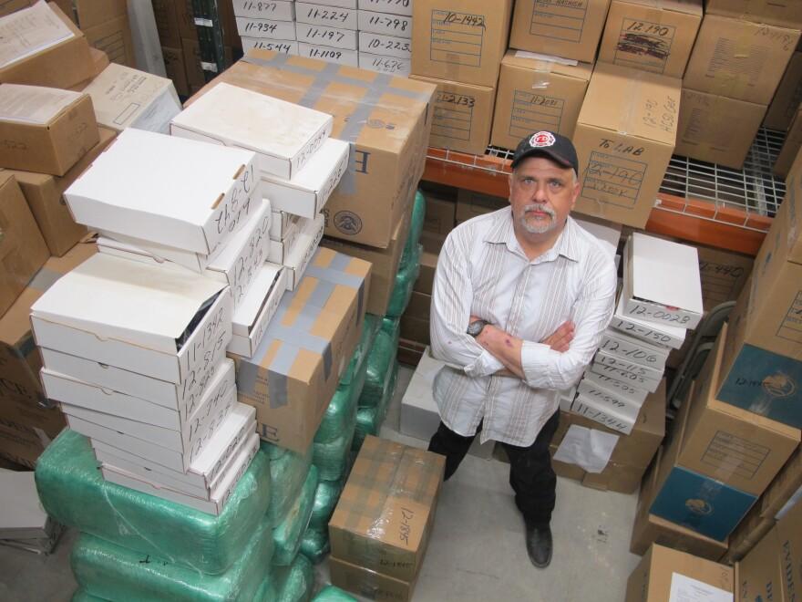 Rusty Fleming, spokesman for the Hudspeth County Sheriff's Office in Sierra Blanca, Texas, stands in an evidence room where bundles of marijuana seized at the nearby U.S. Border Patrol checkpoint fill the entire building with the smell of pot.