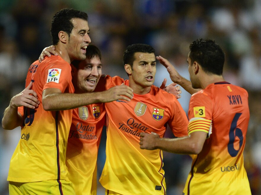 Lionel Messi (second from left) and some of his Barcelona teammates during a match last weekend.