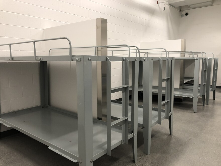 Photo of beds at a new homeless shelter.