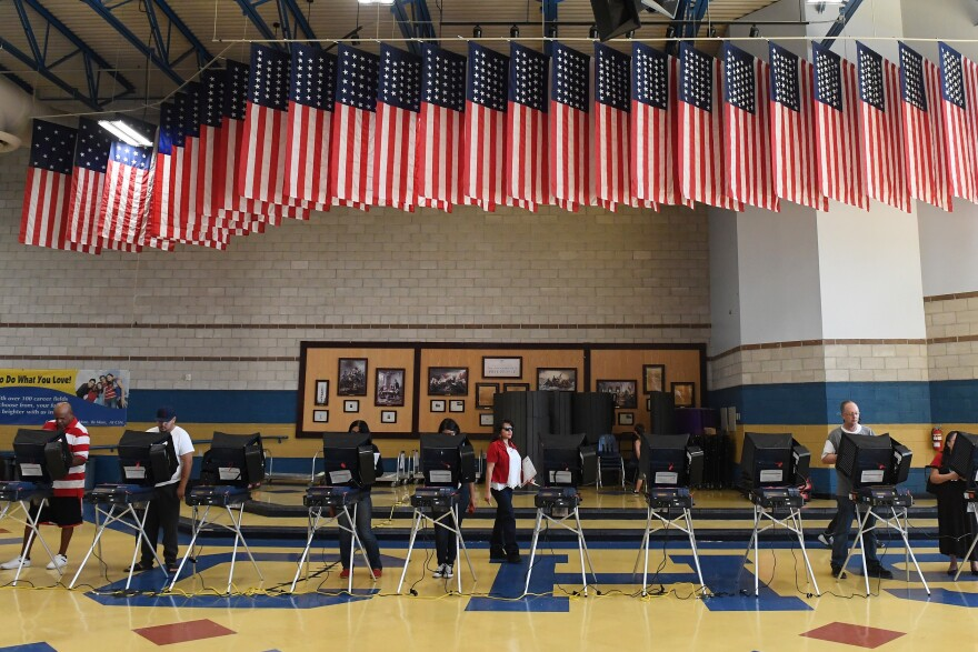 Voters cast ballots at voting machines in North Las Vegas on Election Day 2016. The newly released Mueller report detailed more about Russia's efforts to hack election-related systems.