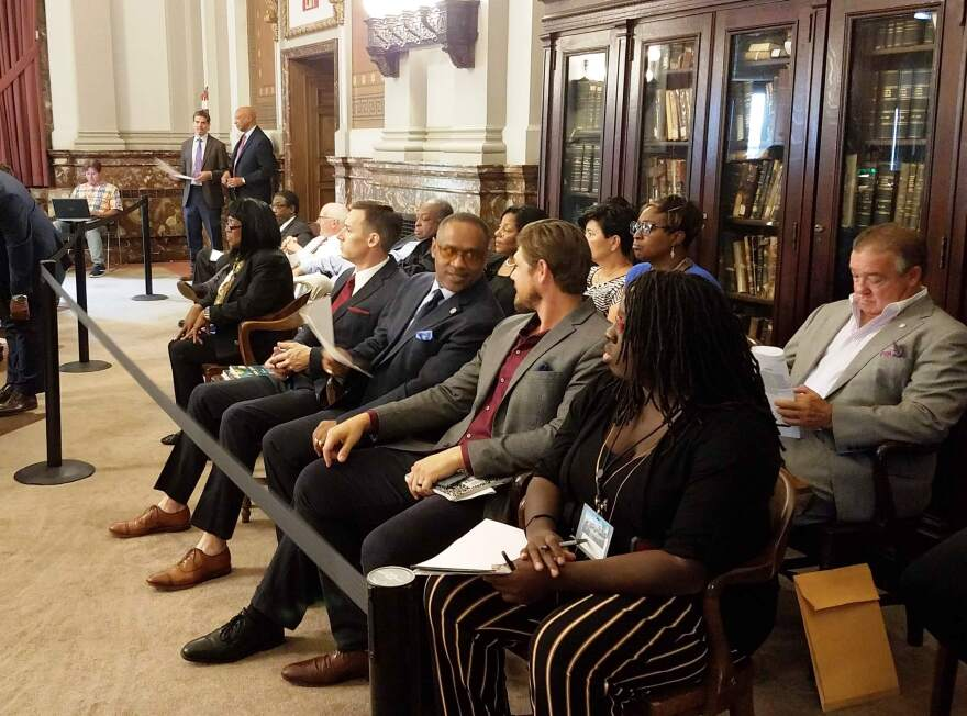 Honored guests, included representatives from IAFF Local 73, Ameren and AT&T watch the proceedings of the Board of Aldermen on Sept. 21, 2018. A proposed new bill would limit who can be on the floor as an honored guest.