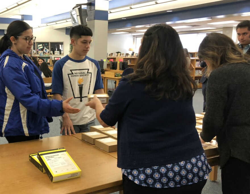 Lanier High School students pick up free internet hotspots Dec. 6, 2019.