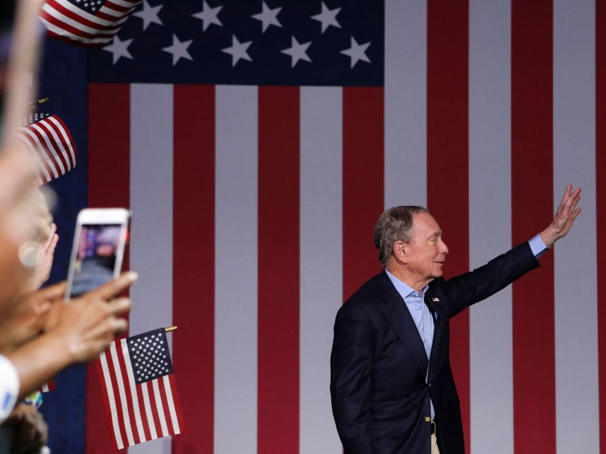 Former New York Mayor Mike Bloomberg waves during a rally in West Palm Beach, Fla., on Super Tuesday.