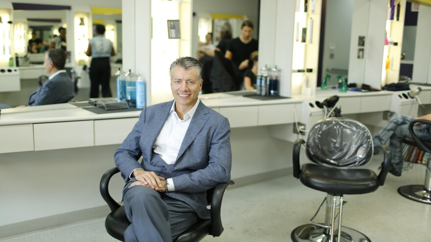 Gary Robins sits in the chair of his Supercuts salon in Media, Pa., one of 41 he owns throughout Philadelphia and Delaware.