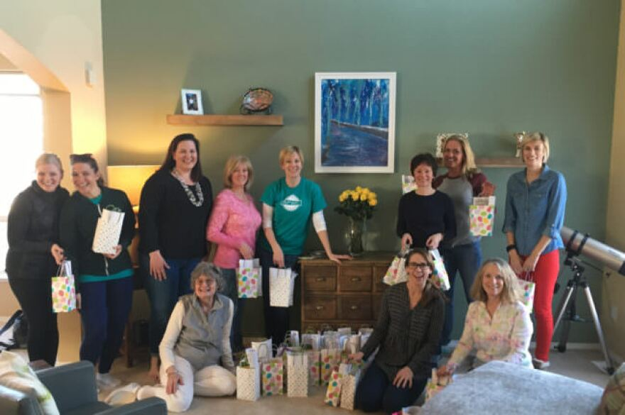 Members of the Anchorage Petroleum Wives Club — soon to be the Anchorage Petroleum Women's Association — pose by the Easter goodie bags they assembled for a youth homeless shelter. (Courtesy Holly Lee)