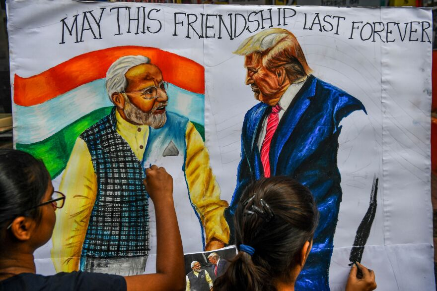 Students in Mumbai draw the likenesses of Indian Prime Minister Narendra Modi and President Trump ahead of the U.S. president's visit to India on Monday.