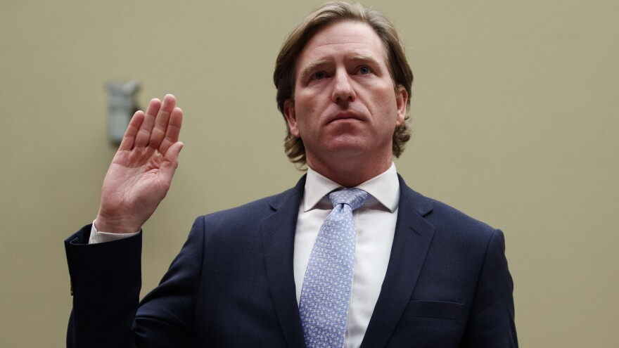 Christopher Krebs, recently ousted as director of the Department of Homeland Security's Cybersecurity and Infrastructure Security Agency, is sworn in to testify last year on Capitol Hill.