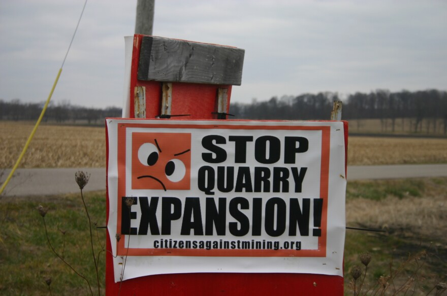 A sign in Mad River Township against the expansion of Enon Sand & Gravel's operation there.