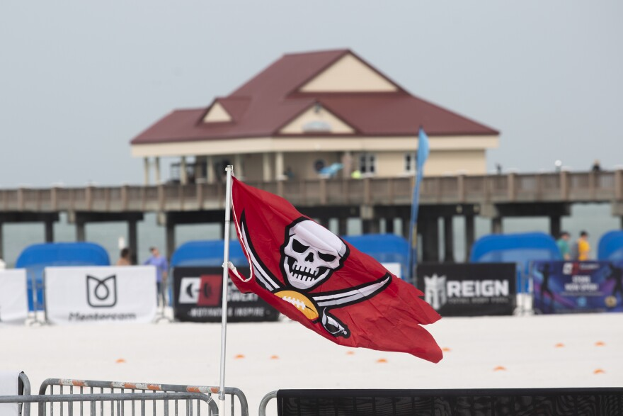 A Bucs flag flies in front of The Pier.
