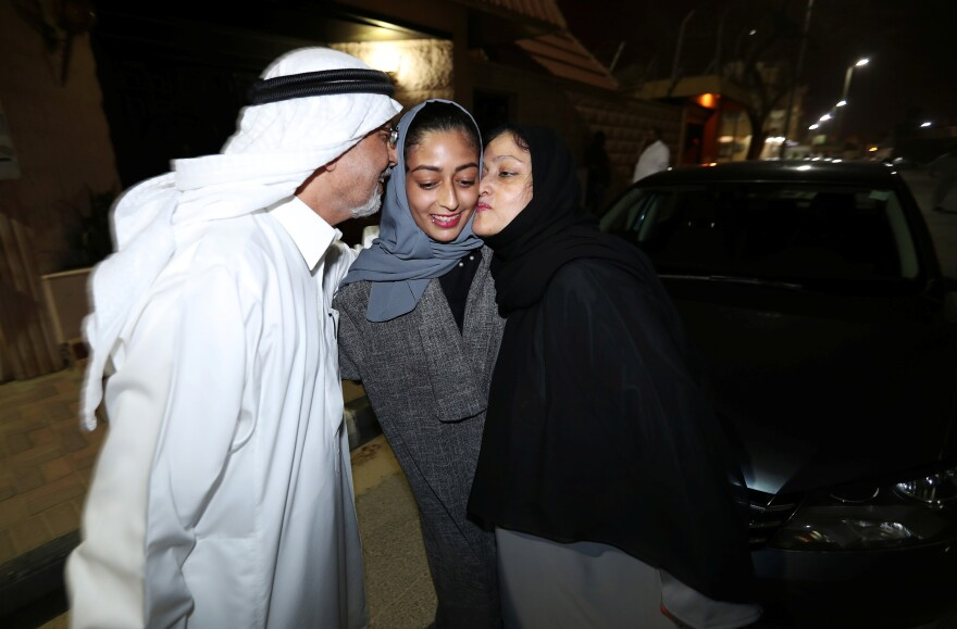 Hannan Iskandar is kissed by her parents after she drove her car in her neighborhood in al-Khobar on Sunday.