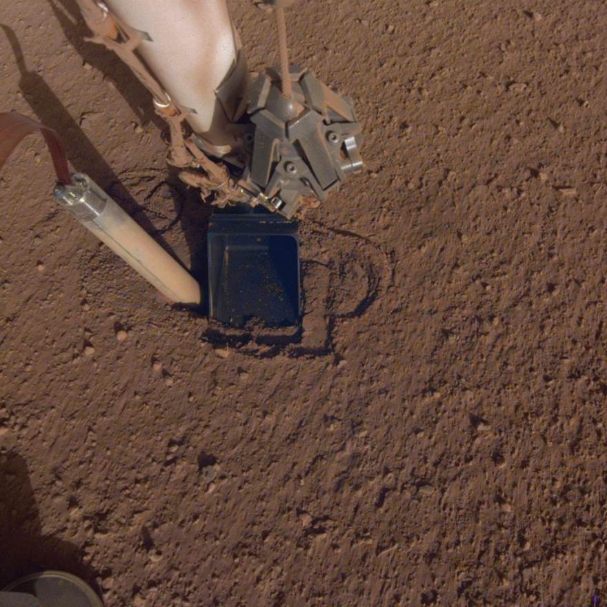 A photo of the mole on NASA's InSight lander trying to drill into the Martian surface.