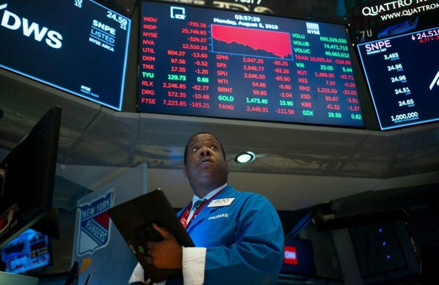 Traders work on the floor at the New York Stock Exchange. Wall Street stocks plunged after a forceful response by Beijing to the latest US tariff announcement escalated an ongoing trade war, exacerbating global growth worries.