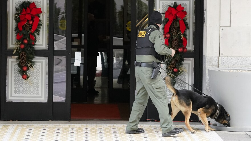 A K-9 team works in the area of an explosion in downtown Nashville, Tenn., Dec. 25. Buildings shook in the immediate area and beyond after a loud boom was heard early Christmas morning.