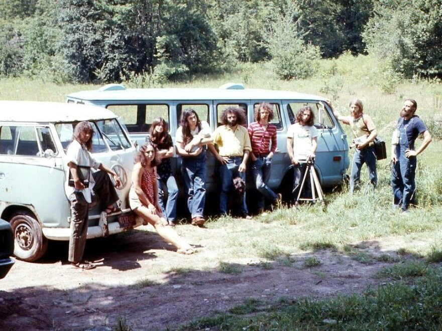 Videofreex including Parry Teasdale and David Cort, fourth and fifth from left, Bart Friedman, third from right, and Skip Blumberg, second from right, gathered in their Catskills town in 1973.