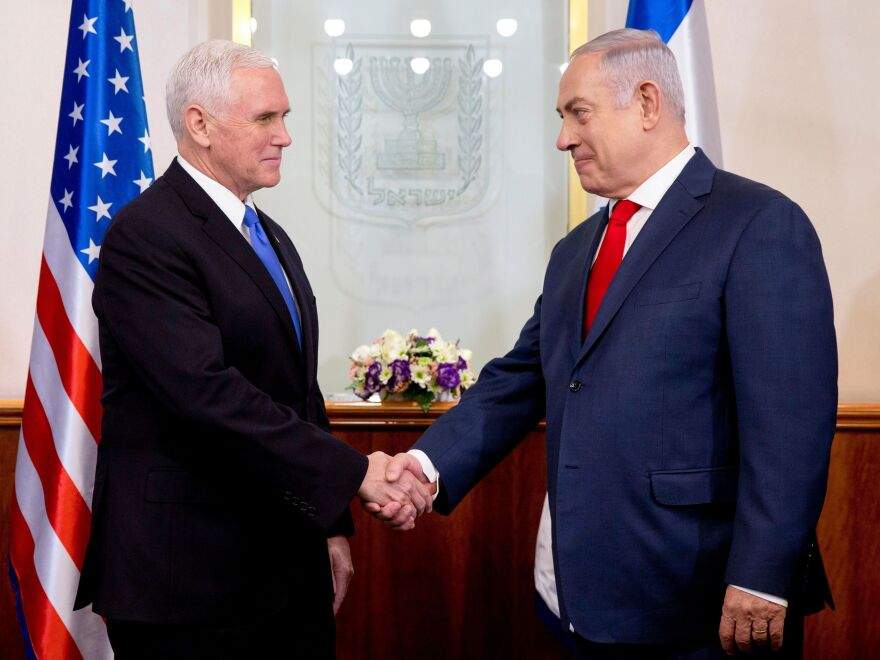Vice President Pence (left) shakes hands with Israeli Prime Minister Benjamin Netanyahu during their meeting at the prime minister's office in Jerusalem on Monday. The visit, initially scheduled for December before being postponed, is the final leg of a trip that has included talks in Egypt and Jordan as well as a stop at a U.S. military facility near the Syrian border.