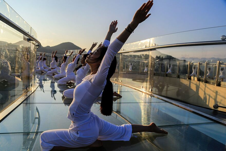 One example: Fifty women practice yoga on the skywalk at the Longgang National Geological Park in July in Chongqing, China.